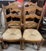 A set of four modern ladder back dining chairs with rush seats