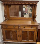 An Edwardian oak mirrorback sideboard with a moulded cornice and pillars,