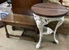 A cast iron pub table, with a circular top,