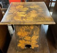 An Art Nouveau inspired occasional table with pen work decoration of flowers and fruits