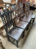 A set of six 17th century style carved oak dining chairs with leaf carved cresting rails and