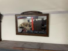 A George III style mahogany wall mirror with a phoenix surmount, the base inlaid with a shell,