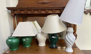 A pair of green glazed table lamps together with three other table lamps