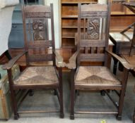 A pair of French carved elbow chairs,