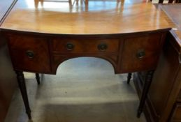 A 19th century mahogany side table with a D shaped top above three drawers on ring turned legs