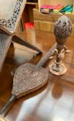 An Indian carved Koran stand together with a similarly decorated bellows and a table lamp