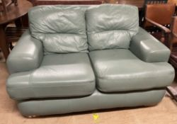 A green leather two seater settee