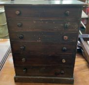A table top collectors cabinet,
