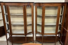 A matched pair of Edwardian mahogany display cabinets, with moulded cornice, glass doors,