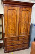 A Victorian mahogany linen press,