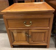 A Chinese hardwood side cabinet with a square top,