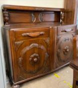 A 20th century oak dining suite comprising a sideboard,
