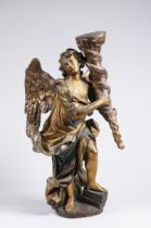 ANGEL - TORCHBEARER 18th century Central Europe Polychrome and gilded wood 58 cm A tall statuette of