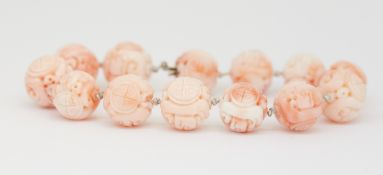 CHINESE CARVED CORAL BEAD BRACELET