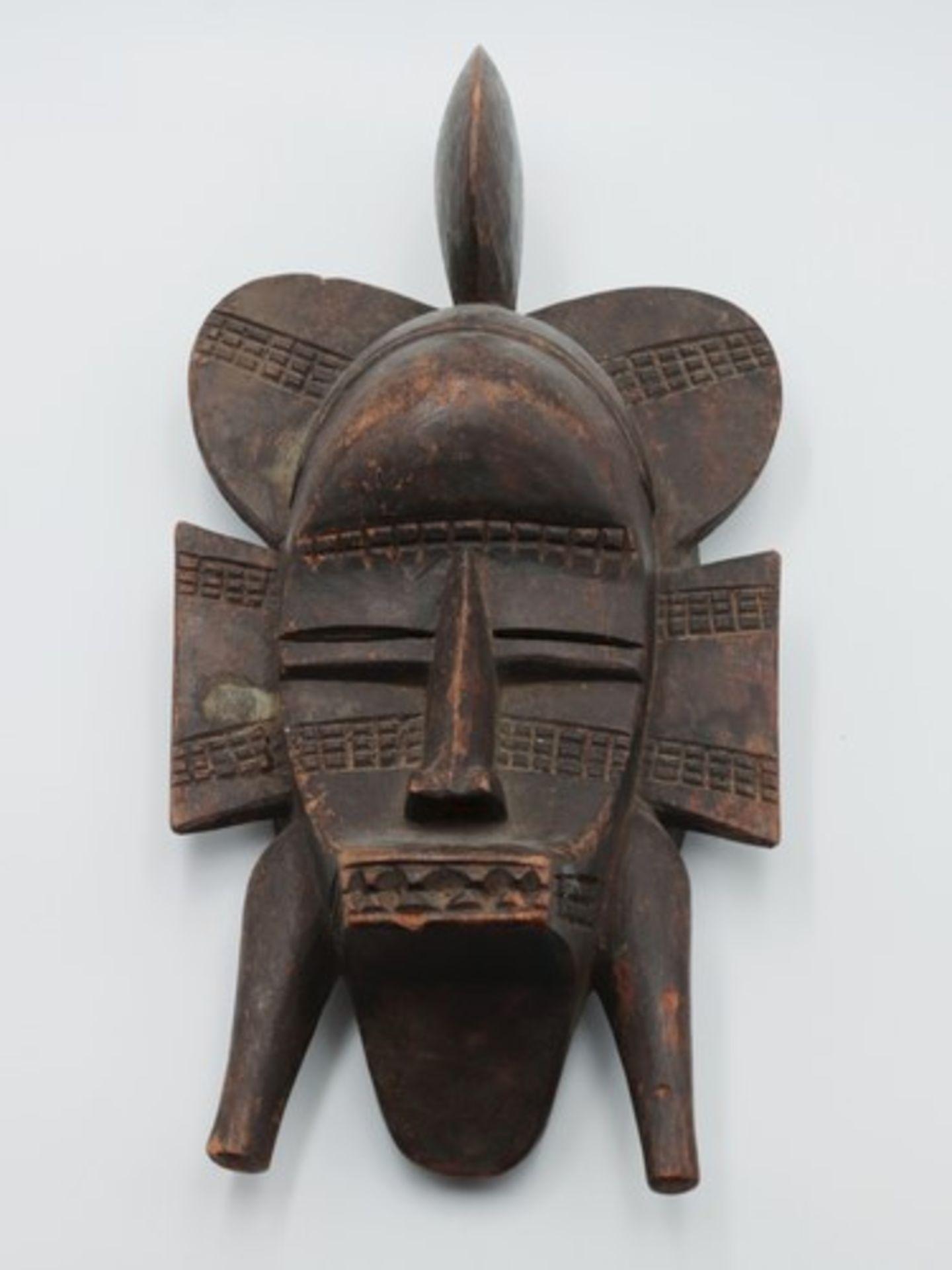 Los 1858 - Maske20.Jh., Elfenbeinküste, vollplastische Holzschnitzerei, wohl Tropenholz, Gesicht m. schmalen