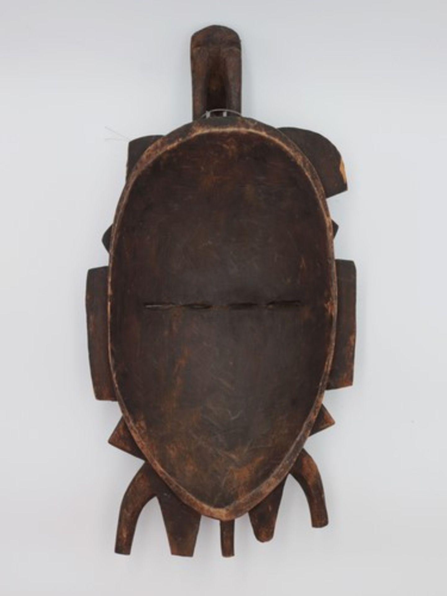 Los 1859 - Maske20.Jh., Elfenbeinküste, vollplastische Holzschnitzerei, wohl Tropenholz, zwei Gesichte m.