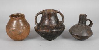 Drei prähistorische Gefäßekleine früheisenzeitliche Terrine mit Kegelhals (wohl Billendorfer