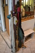 A selection of 14 fishing rods, including a Garcia spinning rod with fixed spool reel, swim feeder