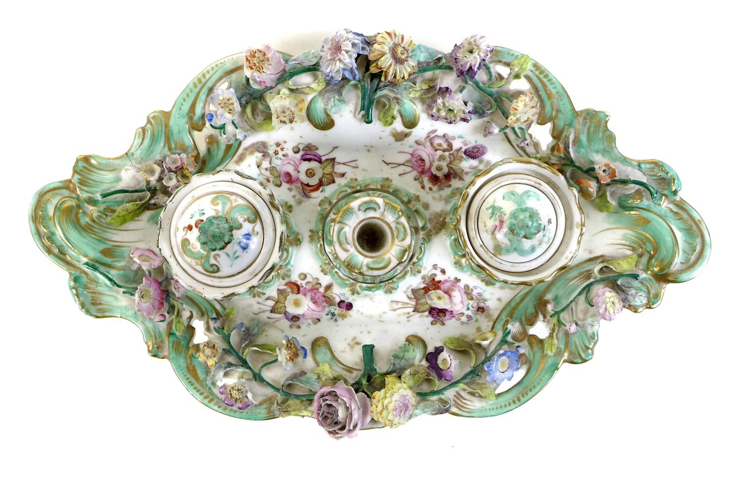Lot 5 - A Continental porcelain desk stand, 19th century, in rococo taste with applied and painted
