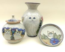 A group of Highland Stoneware pottery depicting cats, comprising a vase signed HEW, 32cm high, three
