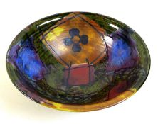 A Dartington Studio Pottery bowl, decorated with geometric shapes, flowers and leaves, with