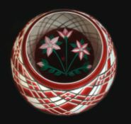 A John Deacons paperweight, with red and white overlaid exterior emcompassing red and white