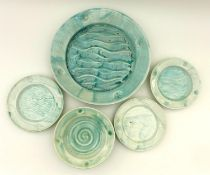A small group of North Shore pottery with an aquamarine glaze, one bowl, three small plates and, one