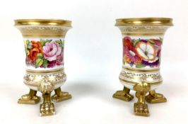 A pair of early 19th century Coalport style porcelain spill vases, each with cylindrical form with