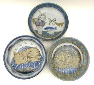 A group of Highland Stoneware pottery, comprising three large bowls each depicting cats, all stamped