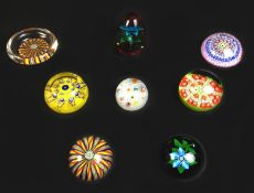 Eight paperweights, comprising of millefiori paperweights with three by Perthshire Paperweights,