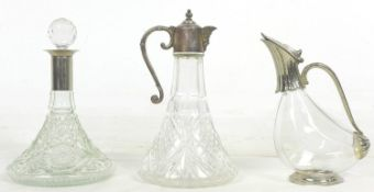 A group of three glass decanters, comprising a ship's decanter with silver plated 'Green Man' mask
