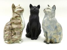A group of three Northshore Ceramic cats, all the same casting but of differing colours and glaze