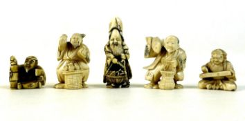 A group of five Japanese ivory katabori netsuke, late 19th and early 20th century, comprising a