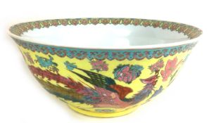 A large Chinese 20th century bowl, decorated with a floral rim to its interior and a phoenix and