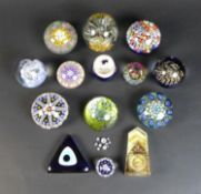 A group of fourteen various paperweights, including five millefiori paperweights, featuring a