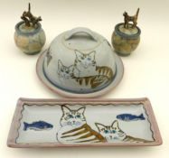 A large group of studio pottery, comprising a jug, six goblets, two cups and saucers, three