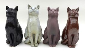 A group of North Shore pottery, comprising four ceramic cats two signed JMR on base, height of