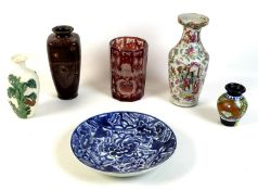 A group of South East Asian vases, comprising a late 19th century cloisonne vase decorated with
