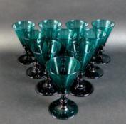 A set of ten Regency Bristol green wine glasses, with conical bowls and knopped stems, rough