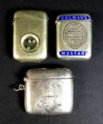 A group of three vesta cases, comprising a Victorian silver example of curved rectangular form,