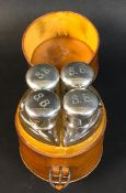 A cased set of four Edward VII silver topped dressing table bottles, monogram engraved 'S.B.',