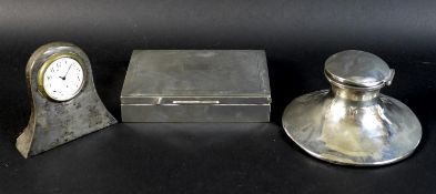 A group of three silver items, comprising a capstan inkwell, Stuart Clifford & Co., London 1912,
