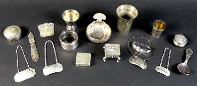 A collection of silver items, comprising three Georgian silver decanter labels, two engraved '