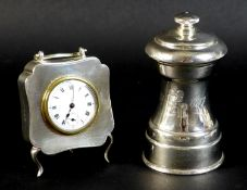 A George V silver cased travel clock of quatrefoil form, with machine turned decoration, rubbed