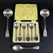 A pair of George III cream ladles, William Eley and William Fearn, London 1818, together with a