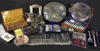 A collection of silver plated wares, including a Mappin & Webb twin handled wine holder decorated