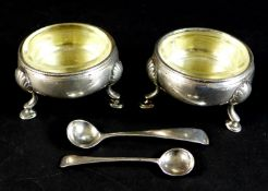 A pair of early George III silver cauldron salts, with parcel gilt interiors, both with engraved