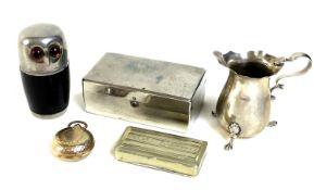 A silver cream jug raised on three pad feet, Walker and Hall, Sheffield 1907, 1.25toz, 7.2 by 3.6 by