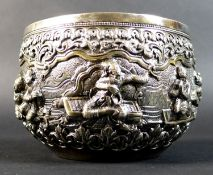 An early 20th century Burmese white metal bowl, intricately repousse decorated and chased with a