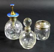 Three silver and cut glass dressing table items, comprising a silver and enamel topped atomiser,
